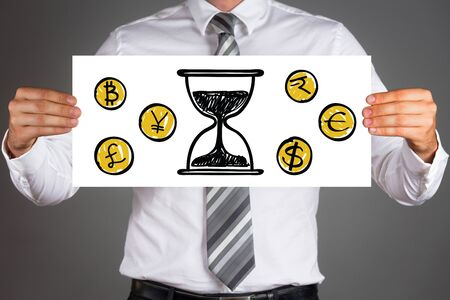 man holding money: Time is money concept.Business man holding paper with drawings of different currencies coins and sand clock.