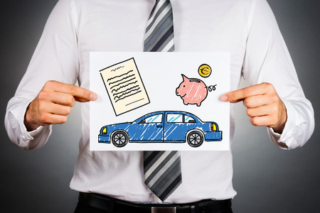 Car loan concept. Businessman holding paper with drawing of a car together with money and contract illustrations. Zdjęcie Seryjne