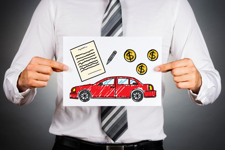 paper money: Car loan concept. Businessman holding paper with drawing of a car together with money and contract illustrations. Stock Photo