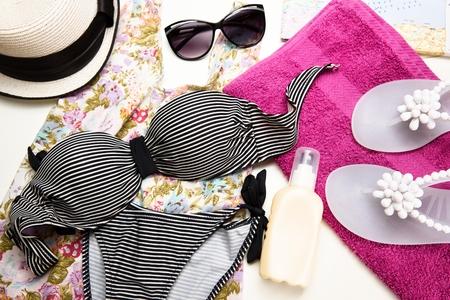 Summer items. Womans beach set. Top view.