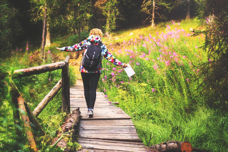 and hiking path: Young woman enjoying a hike through the forest. Stock Photo