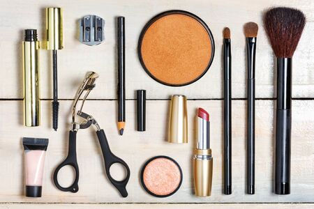 cosmetic product: Set of various make up pieces. Isolated on white wooden background. Top view.