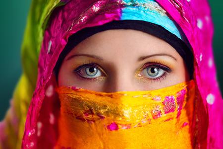 Beautiful Arabic woman wearing colorful hijab.
