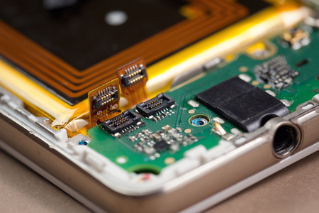 Close up of a mobile phone internal parts.