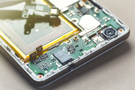 Smartphone disassembly motherboard exposed.
