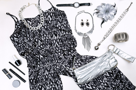 Modern silver and black woman outfit. Clothes and accessories. Top view.