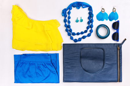 Trendy woman accessories. Blue and yellow casual outfit. Accessories and clothes. Top view.