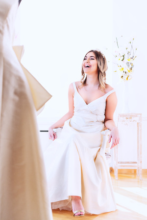 Happy woman, wearing beautiful weeding dress