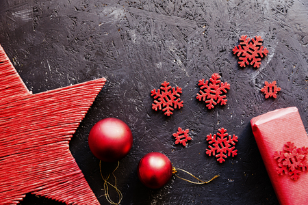 Close-up of red Christmas decorative elements against dark background. Banco de Imagens - 119384138