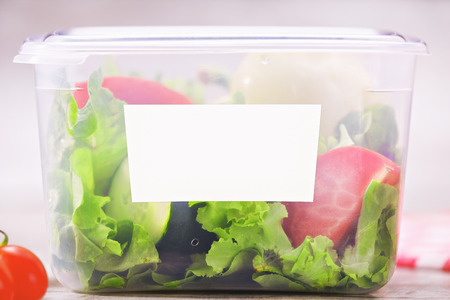 Organic salad inside plastic package. Fresh and tasty salad mock up.