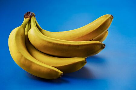 Yellow bananas on the blue background.