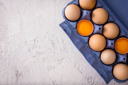 Top view of organic eggs on top of bright background. Banco de Imagens - 128572385