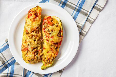 Top view of stuffed zucchini boats with copy space . Banco de Imagens - 128572382