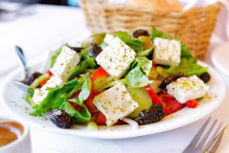 Close up of traditional greek salad, served in restaurant.