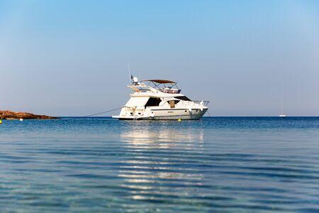 Yacht at the mediterranean sea horizon.