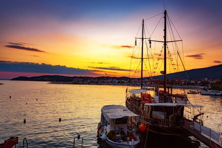 Beautiful sunset over the harbor, with boats in foreground. Banco de Imagens