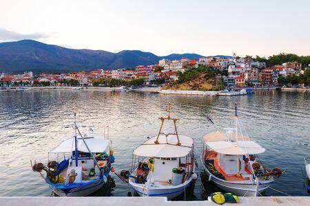 Colorful fishermen boats in harbor at sunset. Banco de Imagens - 128572573