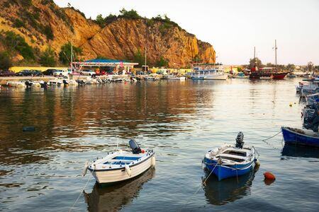 Traditional mediterranean fishing boats in harbor during sunset. Banco de Imagens