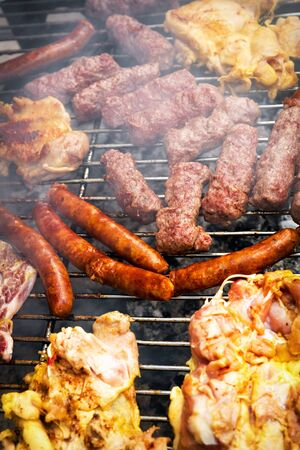 Grilling chicken and pork meat on the grill. Banco de Imagens - 128572635