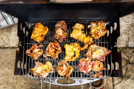 Grilling chicken and pork meat on the grill. Banco de Imagens - 128572640