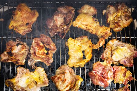 Grilling chicken and pork meat on the grill. Banco de Imagens - 128572642