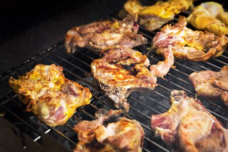 Grilling chicken and pork meat on the grill. Banco de Imagens - 128572644