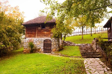 Old, traditional wood and stone peasant house.