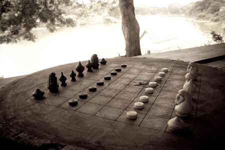 The thai chess game in public park photo