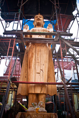 The wooden carve image of buddha thai style photo