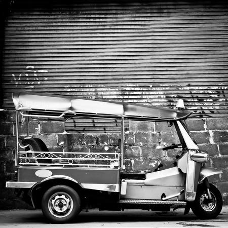 mototaxi: The motor-tricycle or tuk tuk taxi in bangkok thailand Stock Photo