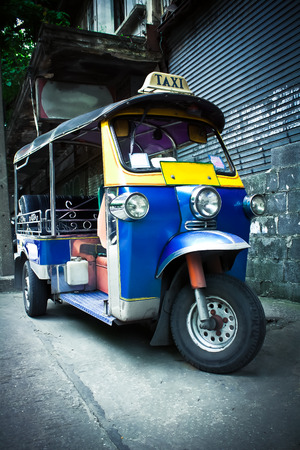 The motor-tricycle or tuk tuk taxi in bangkok thailand Stock Photo