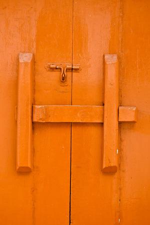 The red wooden temple door in Thailand photo