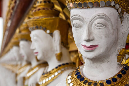 The row of  thai art sculpture in the temple photo