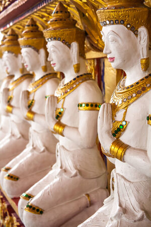 The row of  thai art sculpture in the temple