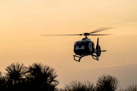 The patrol helicopter flying in the sky photo