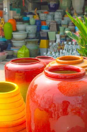 The flowerpot made from baked clay in sunday market Stock Photo