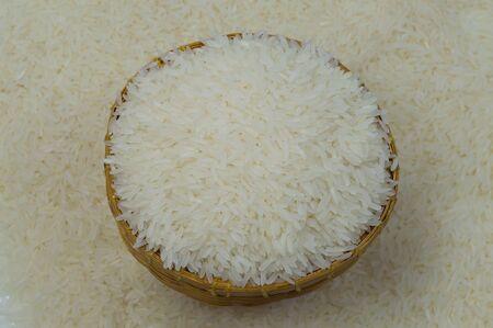 The jasmine rice in small bamboo basket photo