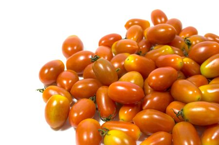studio b: red small tomatoes isolated on white background