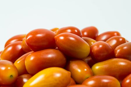 lycopene: red small tomato isolated on white background Stock Photo