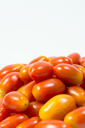 red small tomato isolated on white background photo