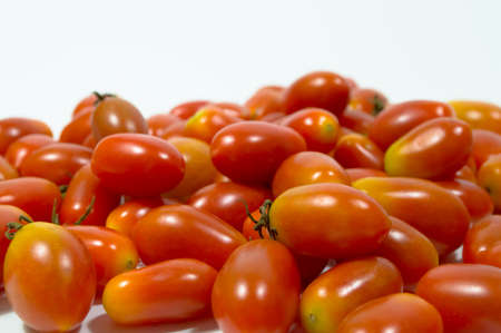 studio b: red small tomato isolated on white background Stock Photo