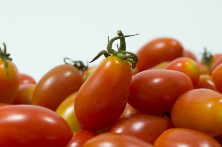 lycopene: red small tomato isolated on white background Stock Photo