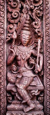 wood carvings: Murals, wood carvings, a Buddhist temple in Thailand.