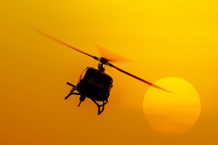 The patrol helicopter flying in the sky