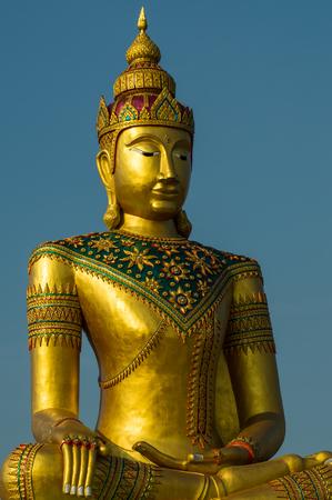 Golden image of buddha thai style on blue sky background Standard-Bild