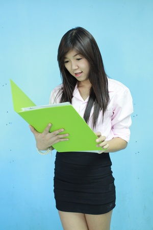 asia women girl carry green portfolio with blue background photo