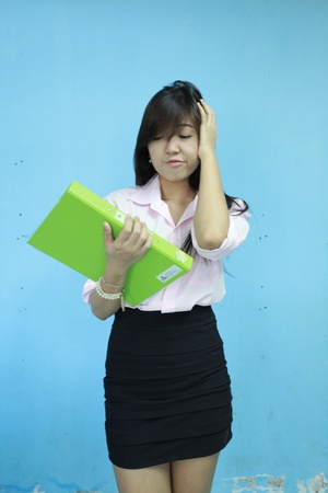 asia women girl carry green portfolio with blue background