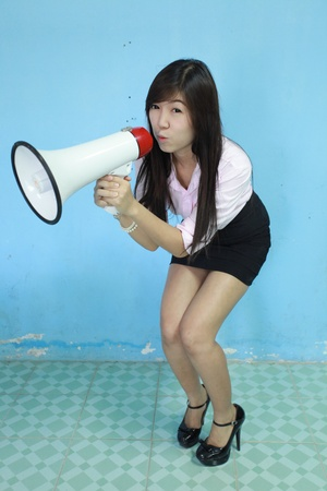asia woman carry megaphone on blue background