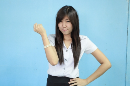 asia woman in student uniform with blue background photo