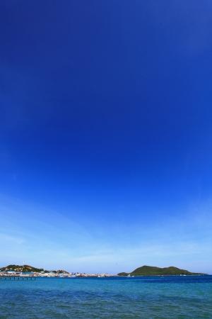Village on the beach with blue sky